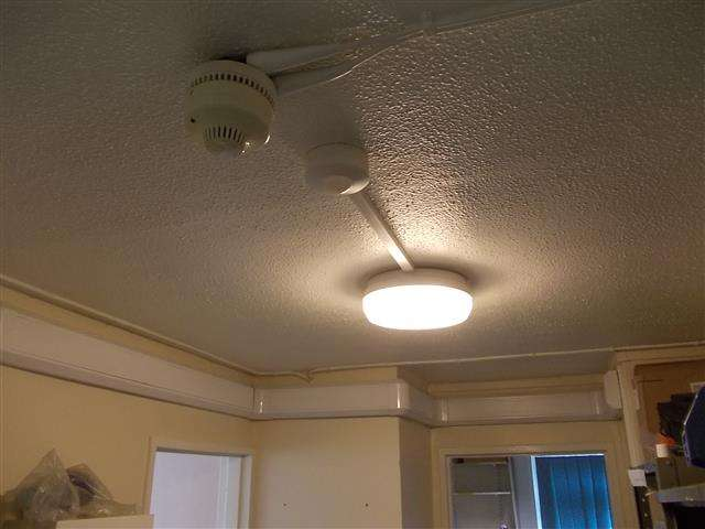 Asbestos textured coating to ceiling in hospital ward