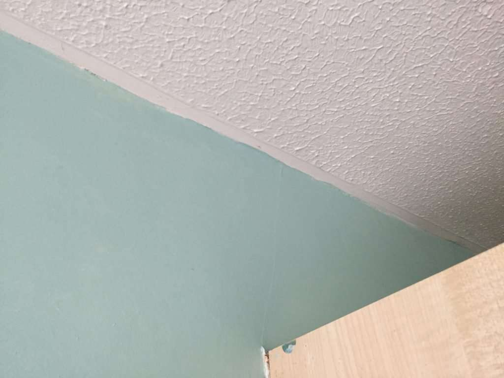 Asbestos textured coating to office ceiling