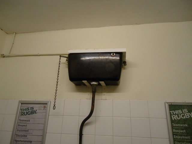 Asbestos toilet cistern in pub