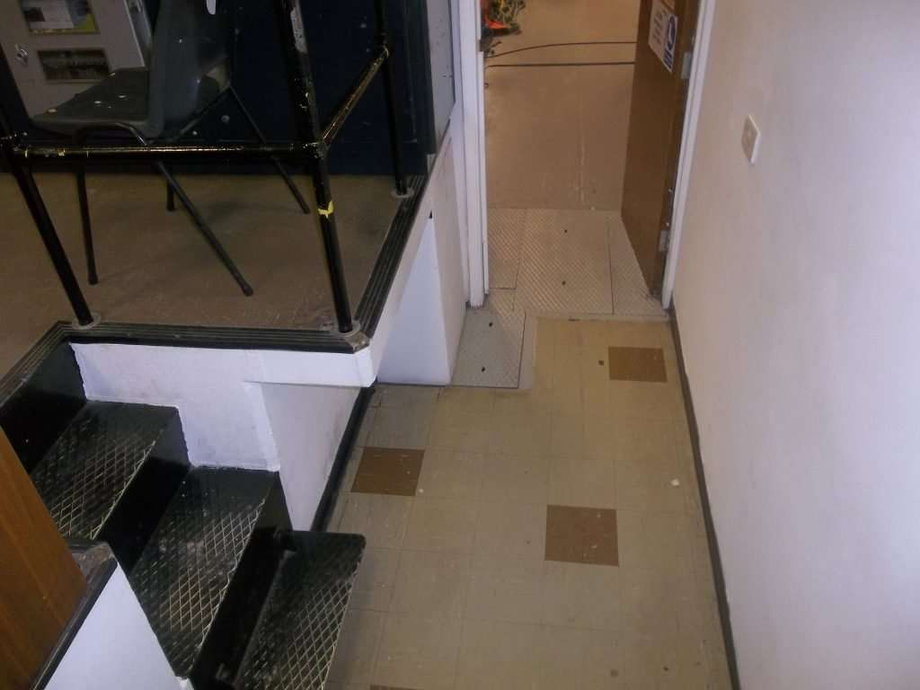 Asbestos vinyl floor tiles in walkway