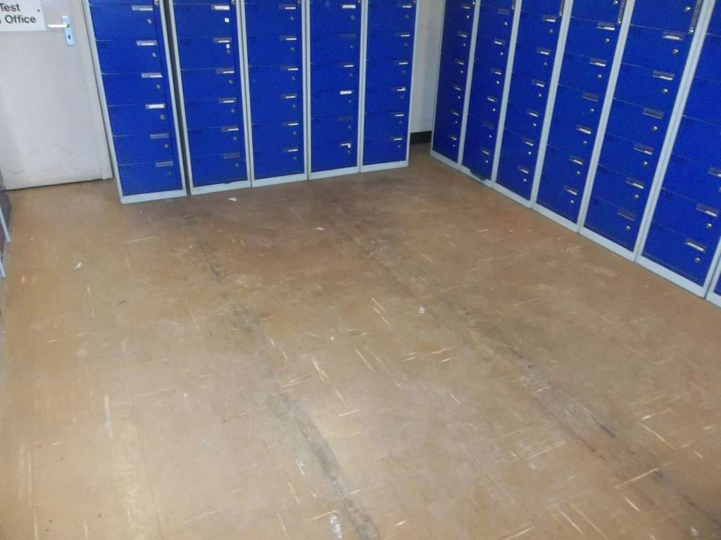Asbestos vinyl floor tiles to Police locker room