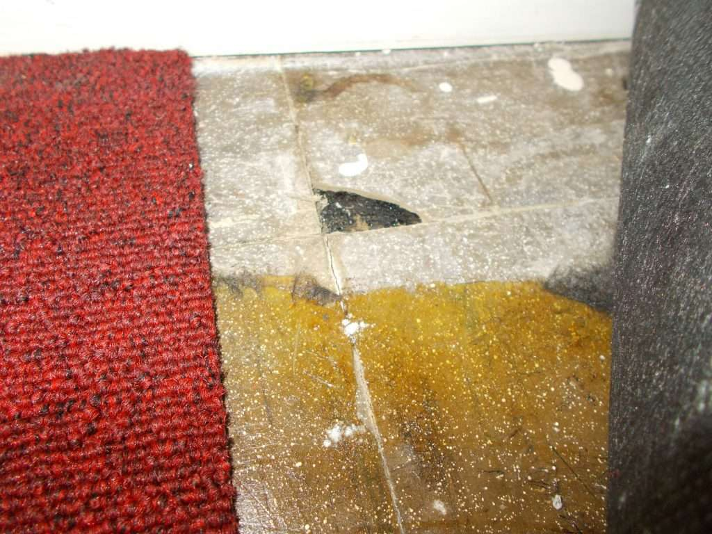 Asbestos vinyl floor tiles with asbestos bitumen adhesive beneath
