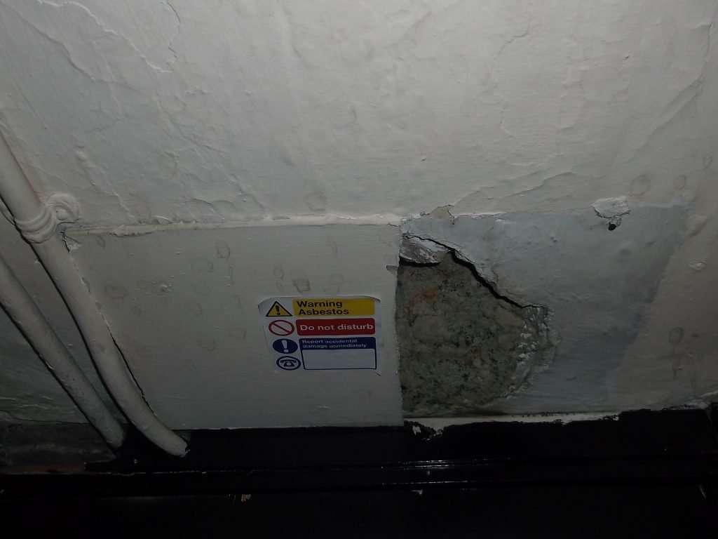 Broken asbestos cement panel