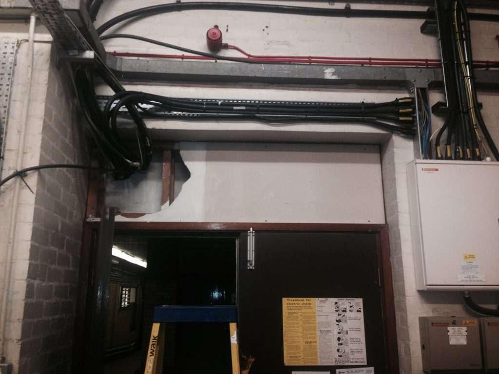 Broken asbestos cement panel in factory