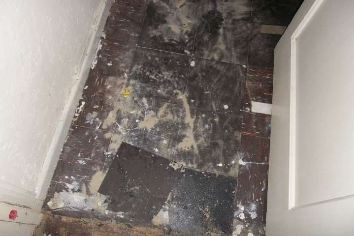 Brown asbestos floor tiles and black bitumen asbestos adhesive