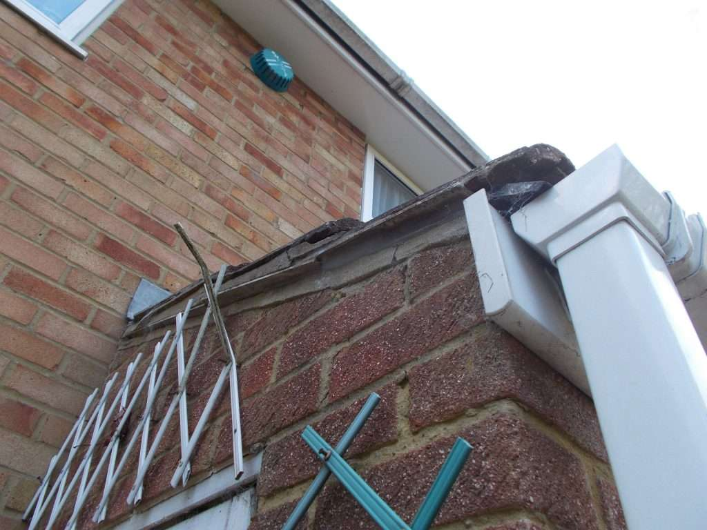 Cement undercloak to roof of house porch