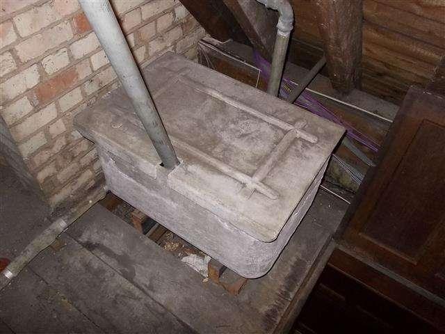 Cement water tank in office loft