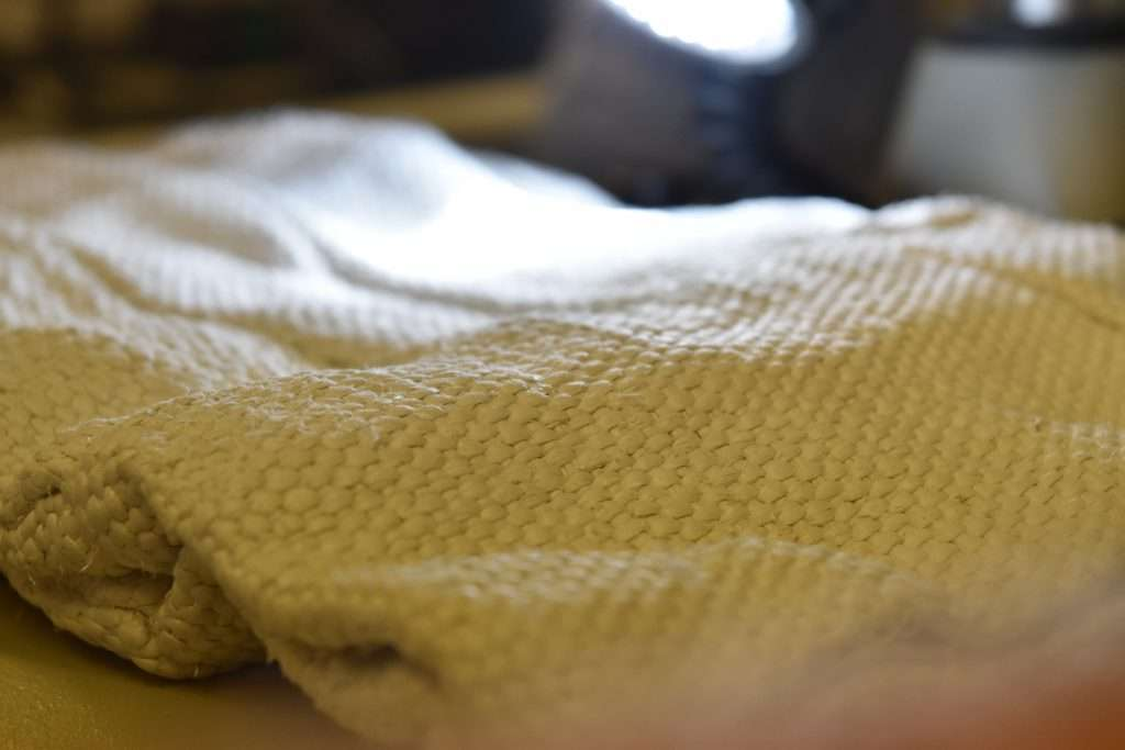 Close up of chrysotile white asbestos woven glove