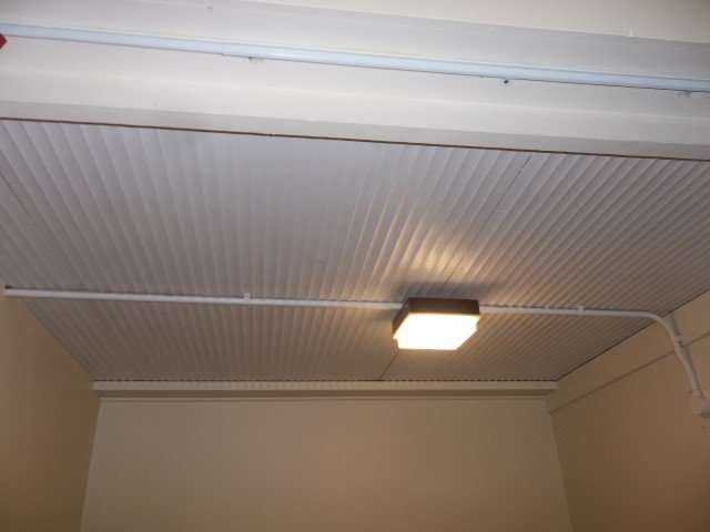 Corrugated asbestos ceiling to ball store in school