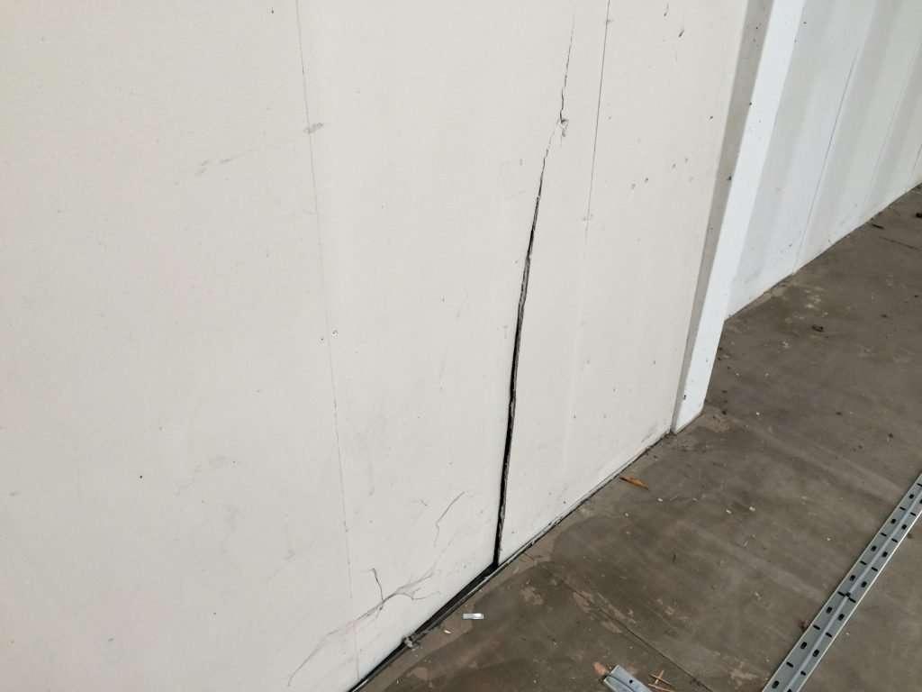 Cracked AIB wall in warehouse