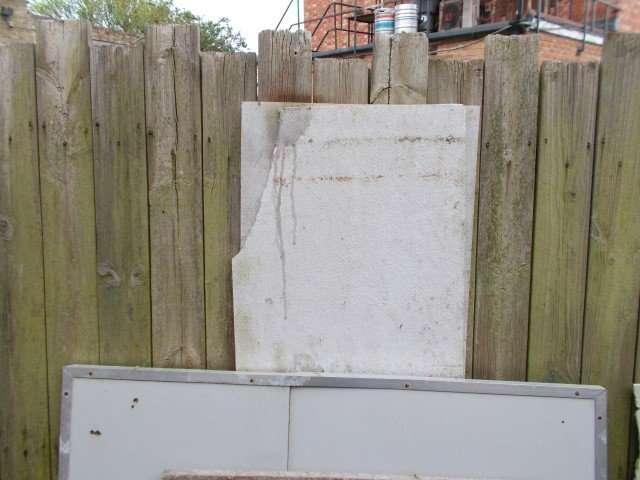 Dumped asbestos cement panels behind office block
