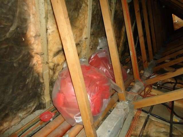 Dumped asbestos waste bags in loft space