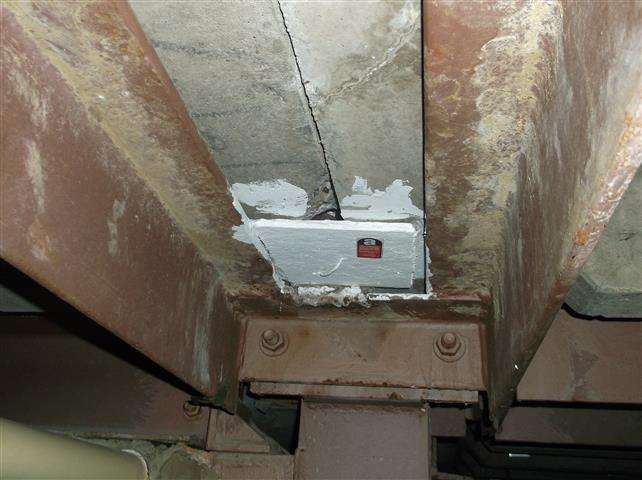 Encapsulated asbestos board in duct