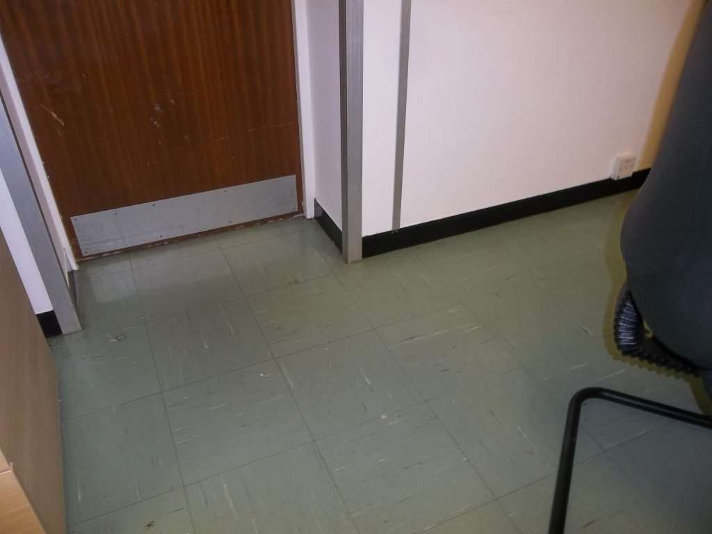 Green asbestos flooring to hallway