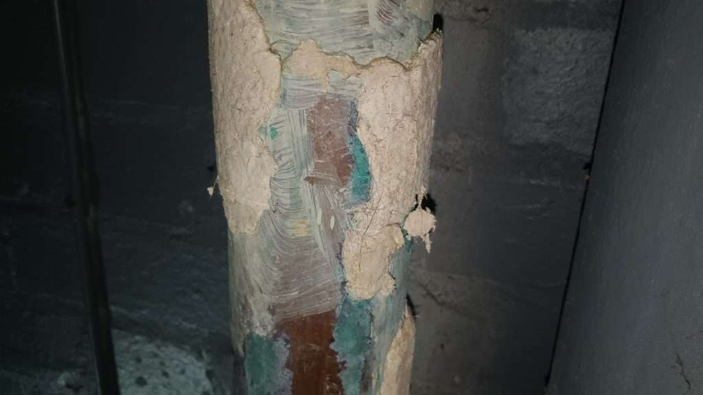 Highly damaged and unsealed asbestos hand applied asbestos lagging
