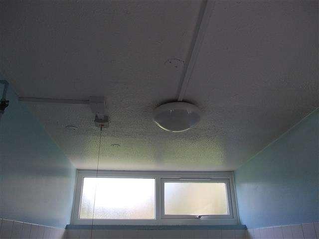Asbestos textured coating to hospital bathroom ceiling