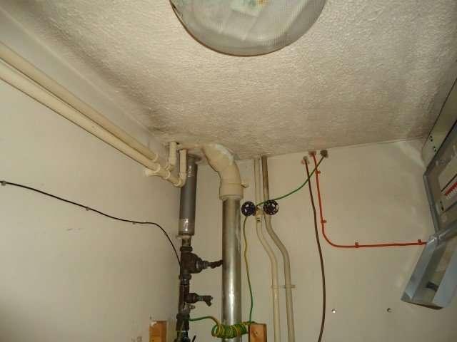 Asbestos Textured Coating to cupboard ceiling
