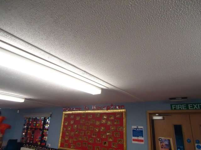 Asbestos textured coating to classroom ceiling
