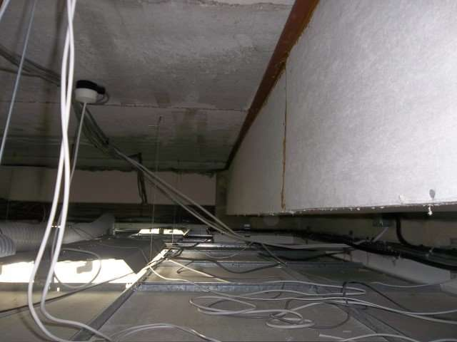 Unsealed Asbestos Insulating boardB in office ceiling void