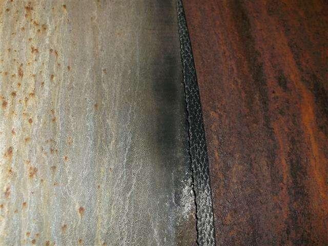 Woven asbestos gasket to boiler casing