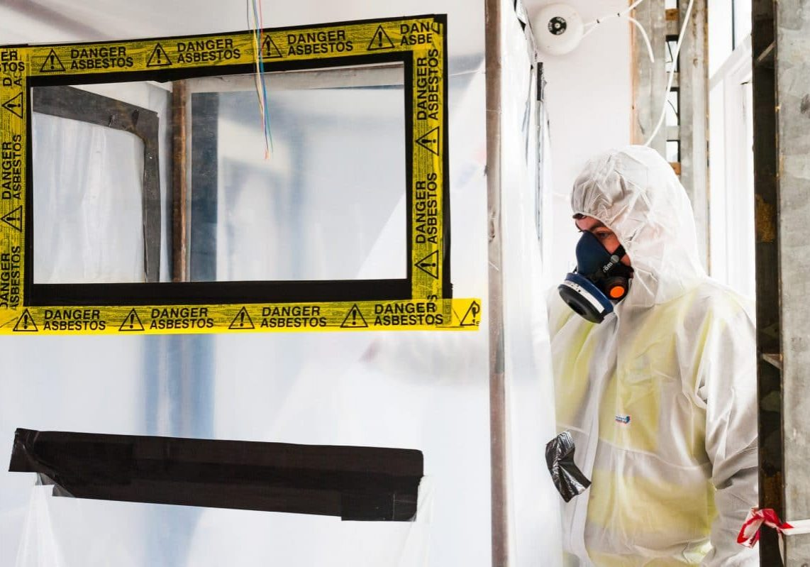 asbestos analyst entering an asbestos enclosure to carry out an asbestos 4 stage clearance